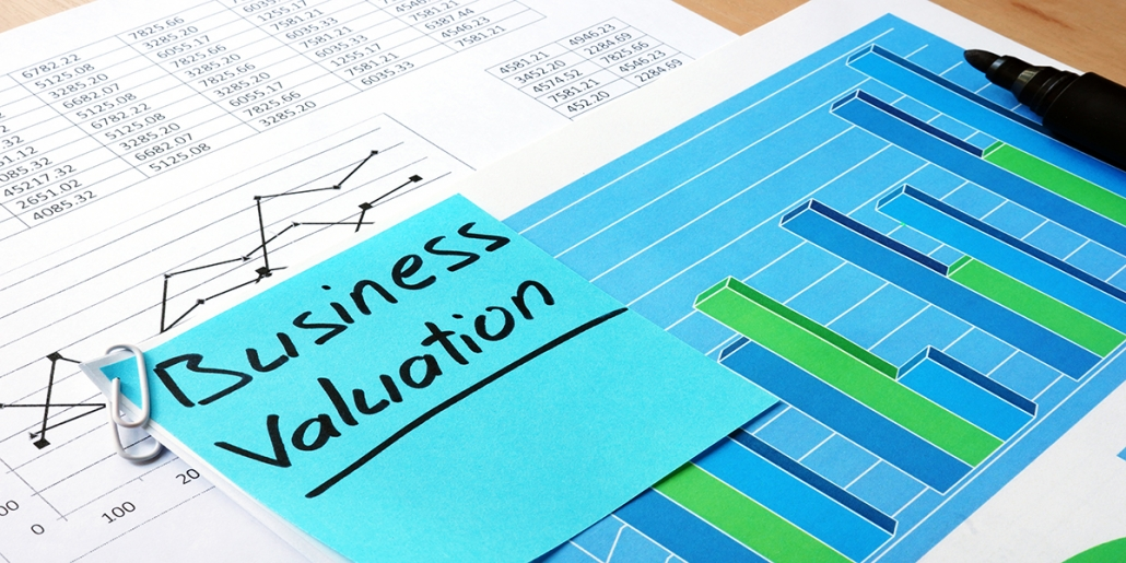 Data of a business valuation presented two pages, one graph and one data with highlighter and sticky note.
